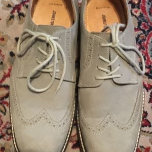 Grey suede wingtip shoes by Johnston & Murphy.